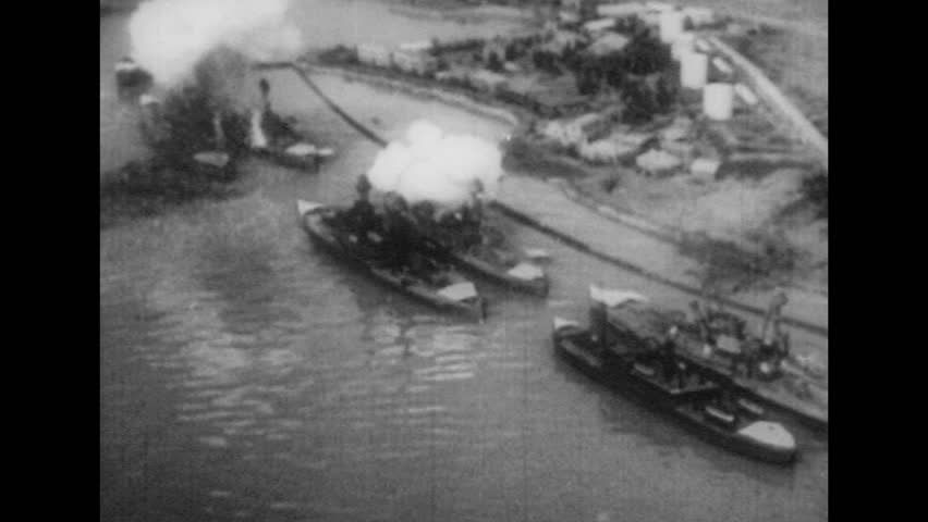 UNITED STATES 1940s: Aerial view of ships being bombed / Japanese plane in air / Aerial of Pearl Harbor / Plane in air / Planes fly through smoke.