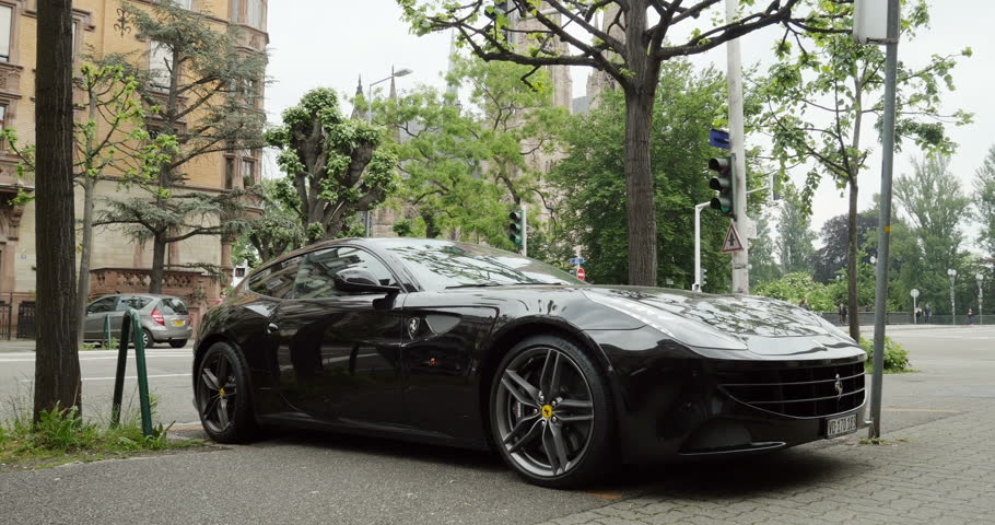 PARIS, FRANCE - CIRCA 2015: Beautiful Ferrari FF model. Parked in city. The Ferrari FF - Ferrari Four is a four seats and four-wheel drive grand tourer and is the fastest four-seat automobile - 4K stock footage clip