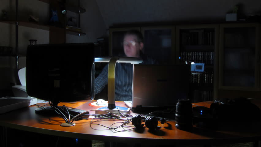 Time lapse. man works behind computers.  | Shutterstock HD Video #1005772