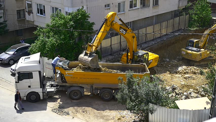 ISTANBUL - MAY 6, 2015: (Slow Motion) Many new constructions are underway. Istanbul is redeveloping neighborhoods to protect against a potential earthquake. Construction site with a digger loader