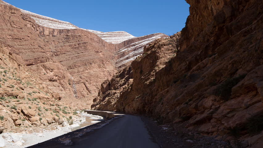a POV shot from the front of an off road vehicle in a rocky canyon, morocco