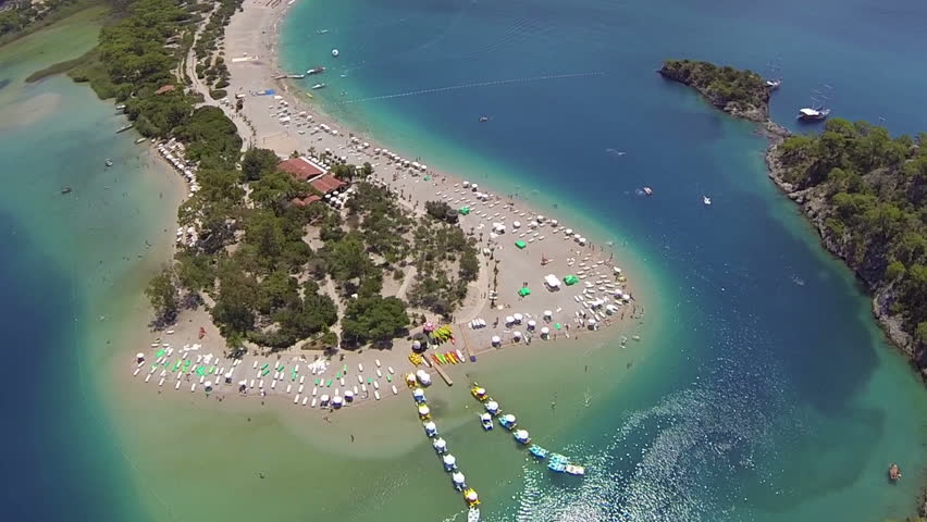 Flying over and tilt down over blue Logoon, Oludeniz Beach