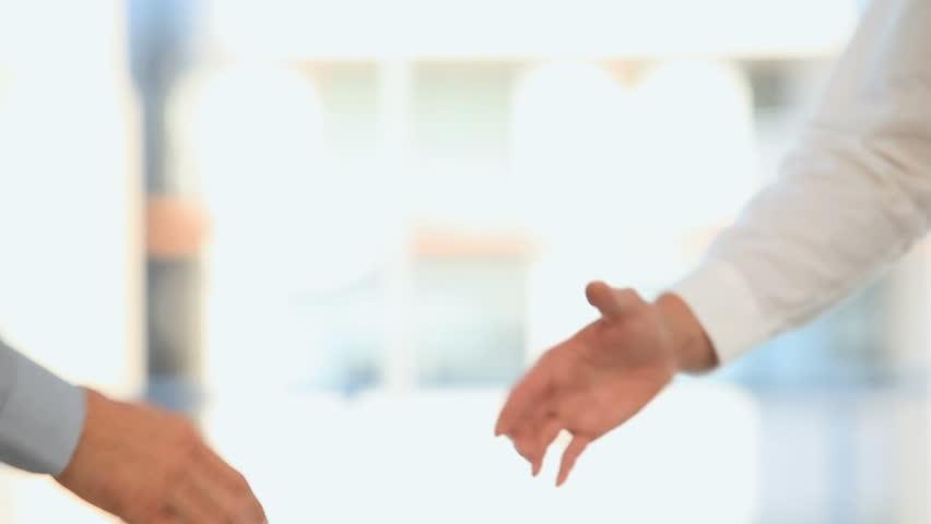 Businessmen shaking hands - HD stock video clip