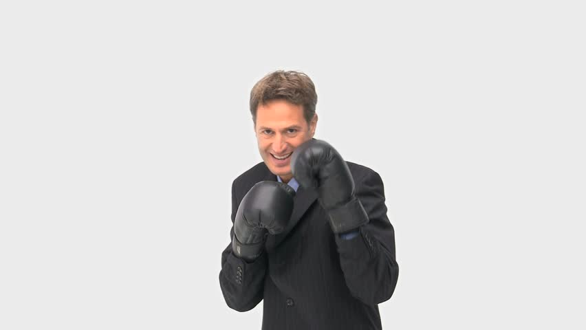 Happy businessman boxing towards the camera - HD stock footage clip