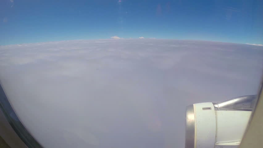Airplane flying into the clouds.