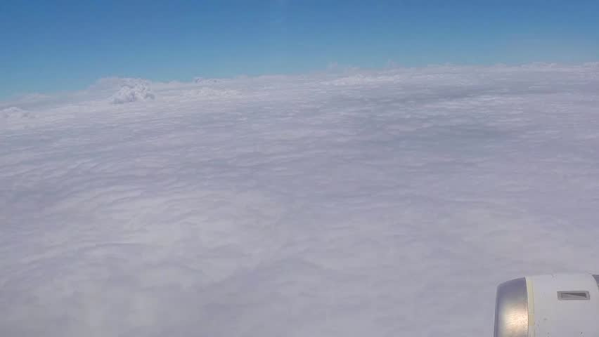 Plane above the clouds. Blue sky