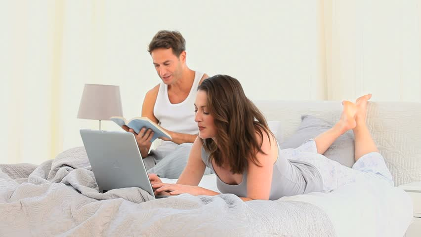 Silly family playing on the bed at home in the bedroom for Role playing ideas for couples in the bedroom