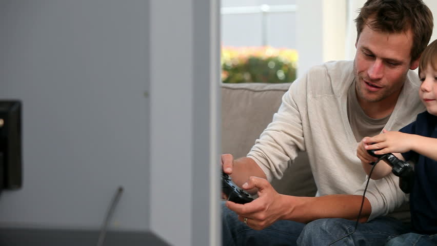 Little boy playing videogames with his father - HD stock footage clip