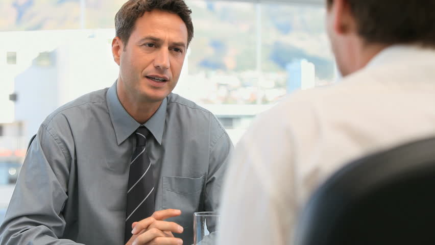 Manager talking with an employee - HD stock video clip