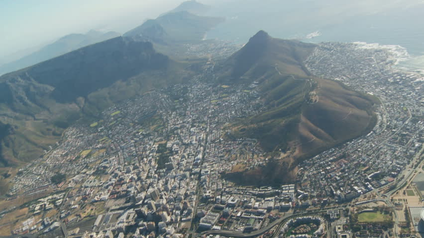 Aerial view of Cape Town city with Table Mountain and World Cup stadium - HD stock video clip