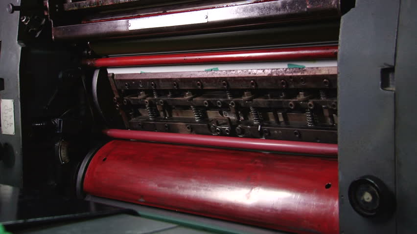 Cylinders on an offset printer. All the photographic images in this clip are property released. - HD stock footage clip