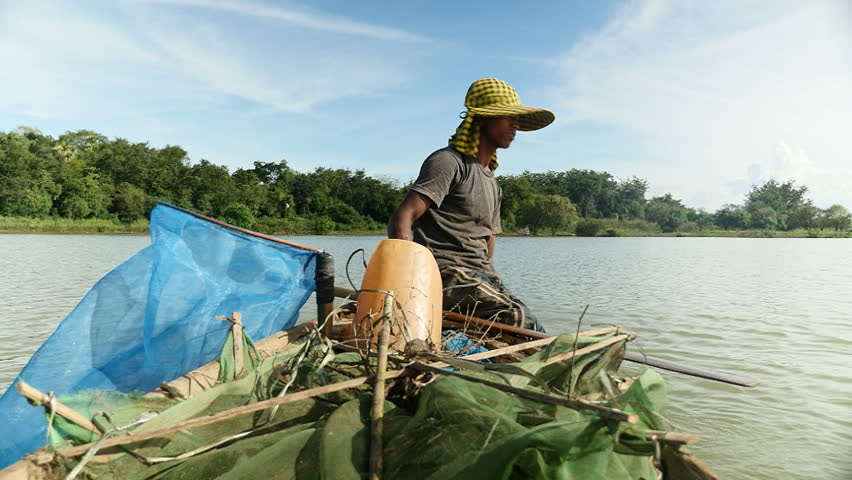 Fisherman rowing  boat for catching shrimp