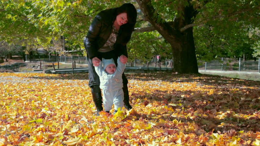 mother walking with baby  - HD stock footage clip