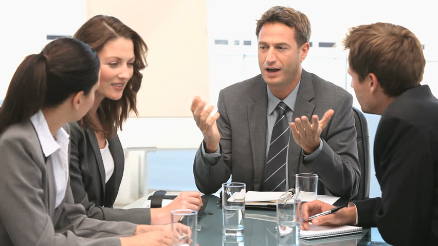 Businessman talking with his coworkers - HD stock footage clip