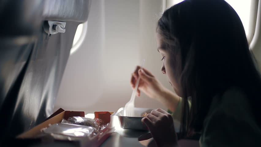 child eating in the airplane - HD stock video clip