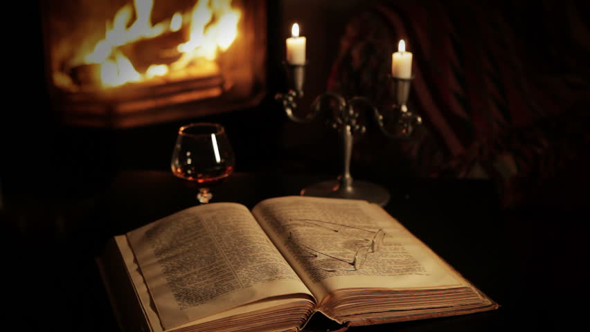A glass of brandy in front of the fireplace - HD stock footage clip