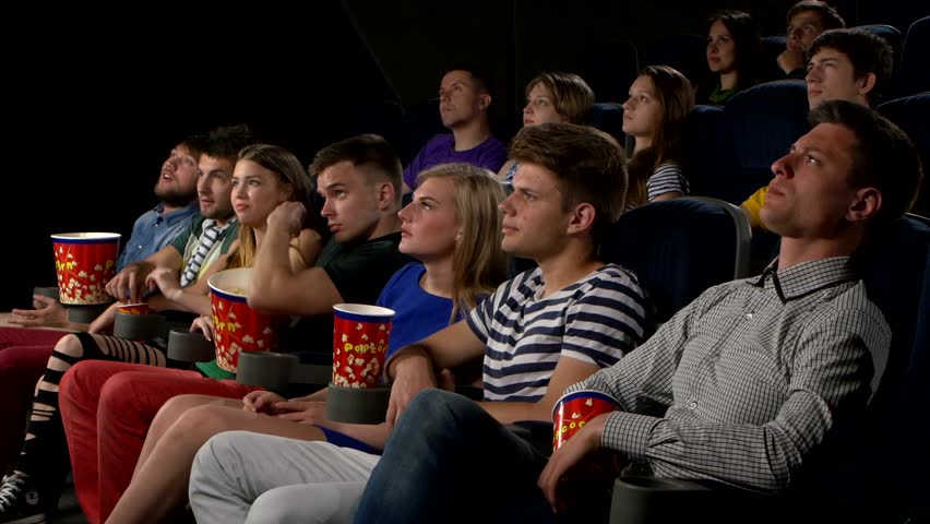 People watching a movie in a theater for People watching