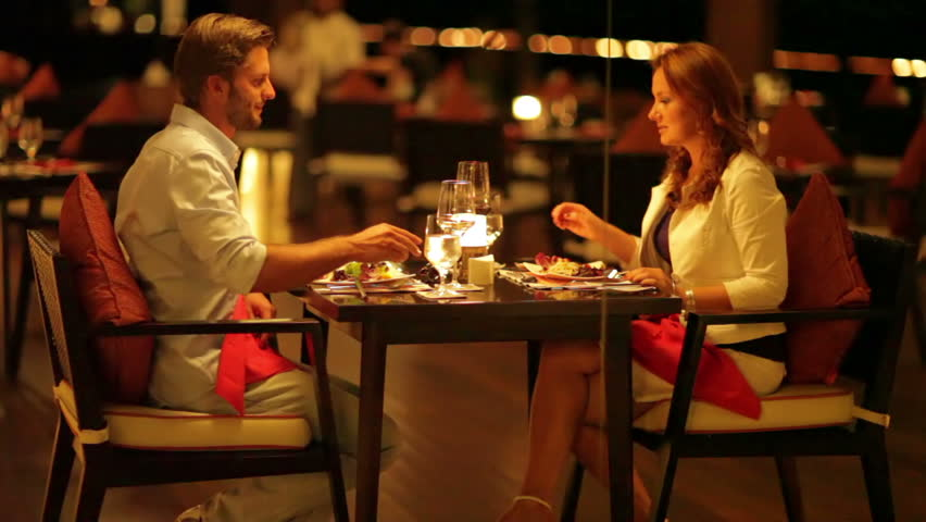 young couple dining exclusively in a romantic atmosphere on a tropical island