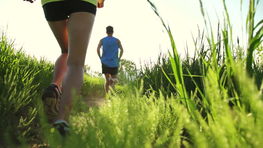 Super Slow Motion Trail Running Outside At Sunset With Lens Flare