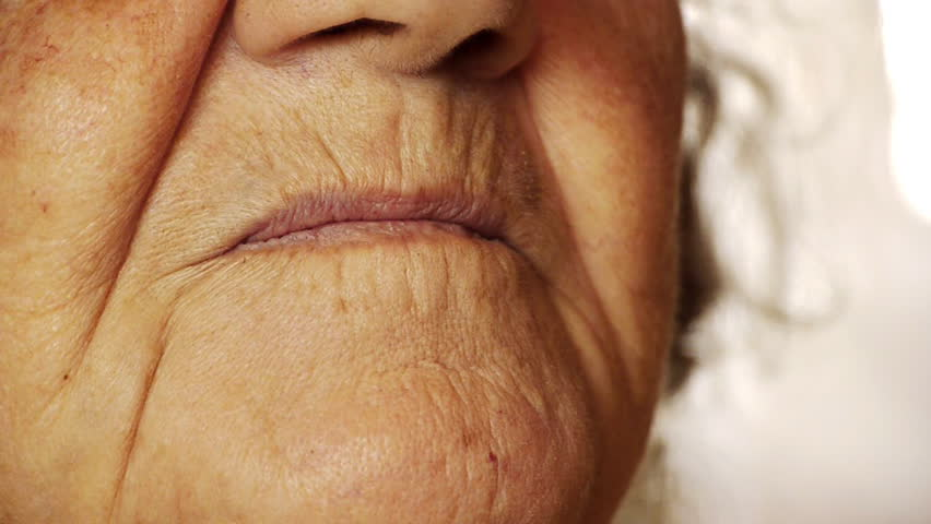 Senior old woman smile mouth wrinkle skin close up  - HD stock video clip