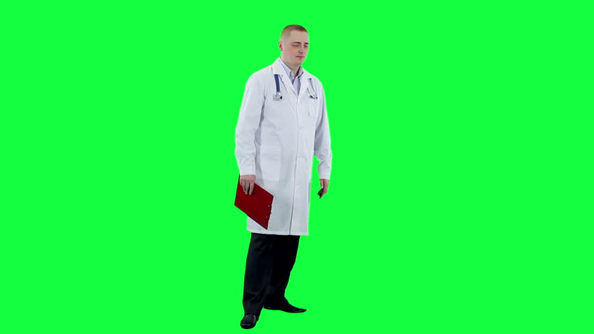 Doctor talking on a phone. Chroma key background. Medic in a white coat answers the phone call
