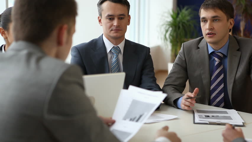 Businesspeople sitting at the boardroom and discussing business-plan