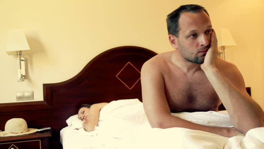 Young couple having problems in bed - HD stock footage clip