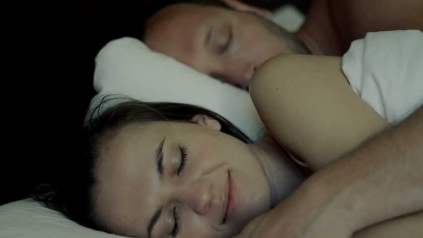 Young couple sleeping together, focus on woman  - HD stock video clip