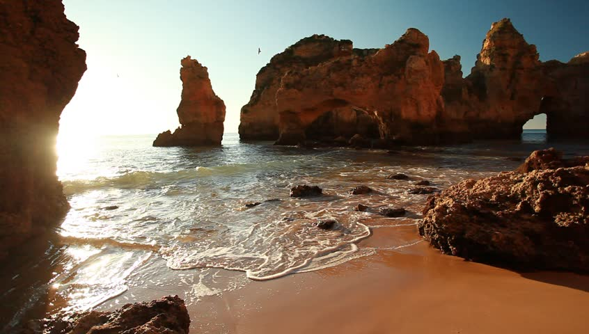 Beautiful sunrise on the rocky atlantic ocean coast in Lagos, Portugal - HD stock video clip