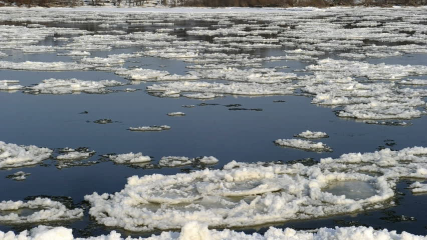 spring thaw, the rivers flowing melting snow, floe and ice - HD stock video clip