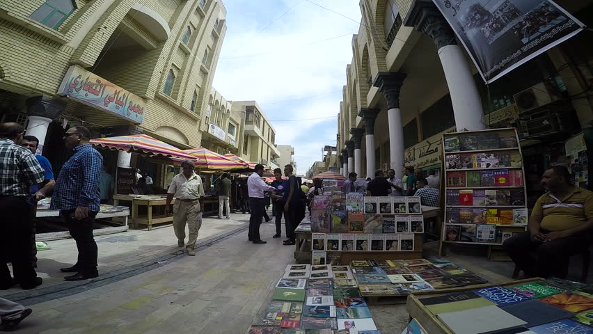 BAGHDAD, IRAQ - MAY 2015: People at Mutanabbi Street in Baghdad. Mutanabbi Street where writers and intellectuals meet is the historic center of Baghdad bookselling