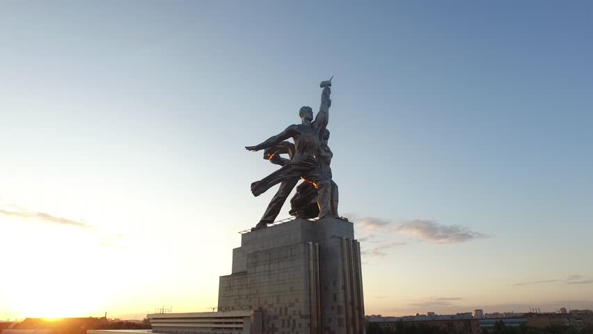 RUSSIA. MOSCOW. JULY 2015: Rabochiy i Kolkhoznitsa (Worker and Kolkhoz Woman) by sculptor Vera Mukhina. Sunset time. HELICOPTER VIEW 1 - 4K stock footage clip