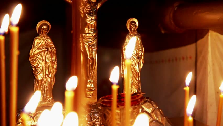 Religious holiday. Worship worshipers light candles.. There is a sound intershum.