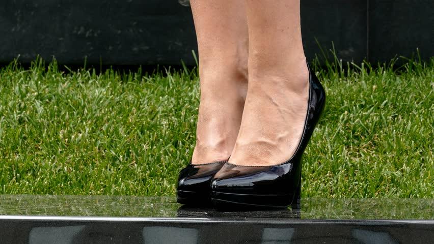 Female Legs High Heels On Table Stock Photo (Edit Now