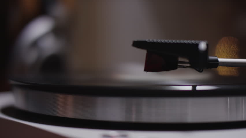 Record player turntable 4k stock footage. A record player turntable with it's stylus running along a vinyl record