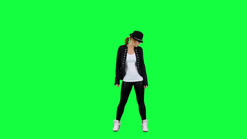 Girl in the hat dancing like the king of pop. Chroma key background. Young woman dancing against a green background