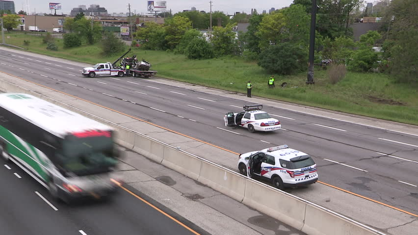 Toronto, Ontario, Canada - June 2015 Fatal car accident scene on highway car cut in half and police investigating