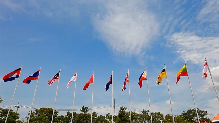 ASEAN flag among the national flags of Southeast Asia countries on blue sky background with the copyspace above - HD stock footage clip