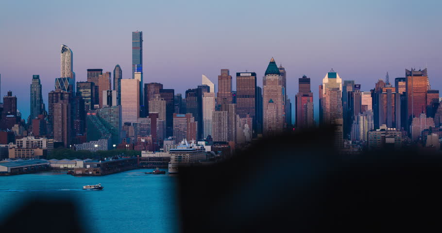 New York City- May 2015- Timelapse- a motion timelapse of NYC skyline of the sunset. Skyline lights beautifully visible as background becomes very dark.