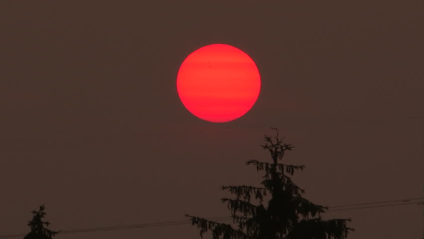 Waterloo, Ontario, Canada - July 2015 Spectacular red sunset blocked out by forest fire smoke from northern Canada