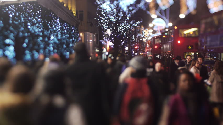 LONDON - DEC 24: Foot traffic on Oxford Street, Dec 24 2010, London, England.  Oxford Street is a major thoroughfare in the City of Westminster in the West End of London, England. There are 548 shops in Oxford Street and it is Europe's busiest shopping st - HD stock footage clip