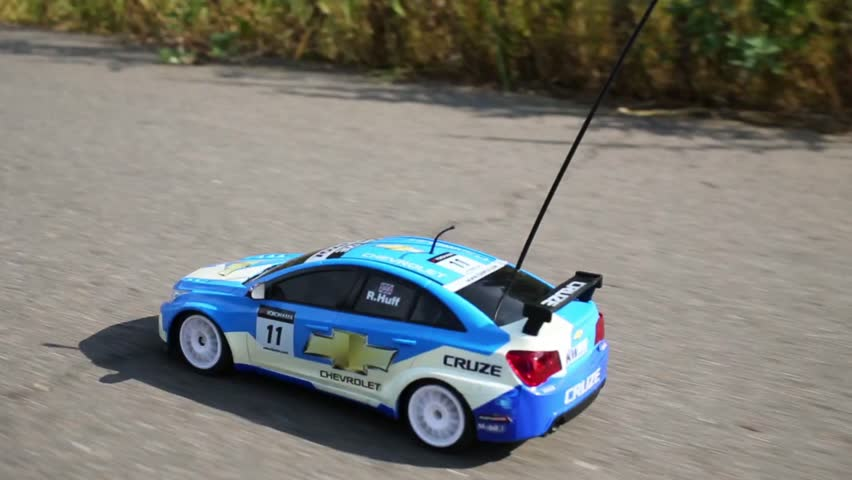 MOSCOW - AUG 9, 2014: Radio controlled car Chevrolet on road. Chevrolet company was founded in 1911 in US