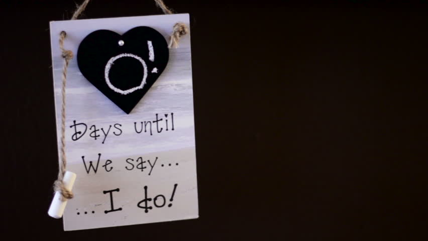 "Sign with the text ""0 Days until we say I do"" hanging on a wall. - HD stock footage clip"