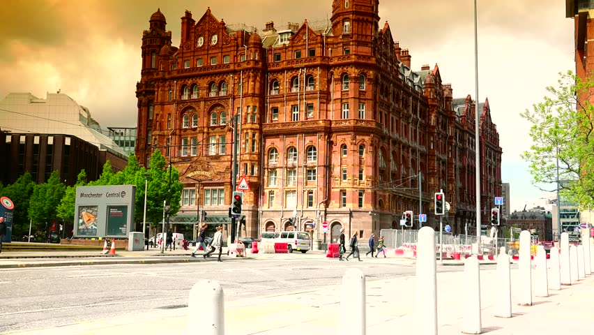 MANCHESTER - ENGLAND,UK, MAY 20, 2015: ULTRA HD 4K, Busy traffic road with pedestrian people walk and car pass by day