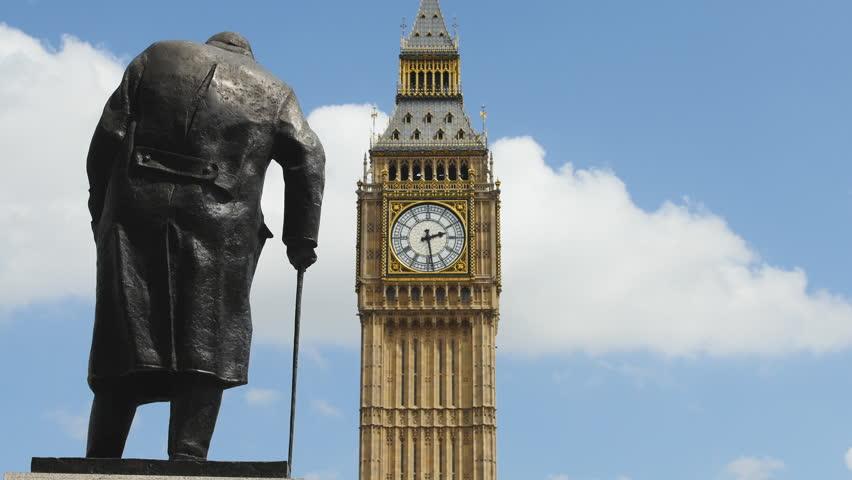 Big Ben facing Winston Churchill statue. London, UK. July 2015.