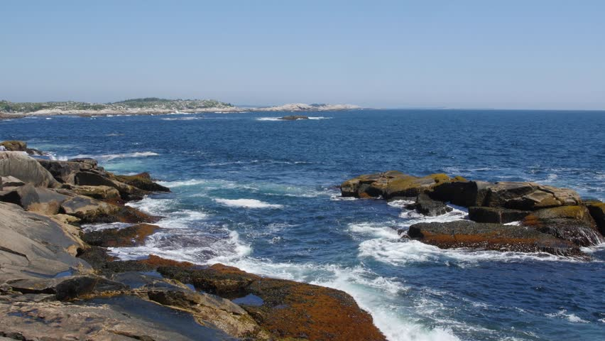 a shot of rough water on a rocky ocean coastline near