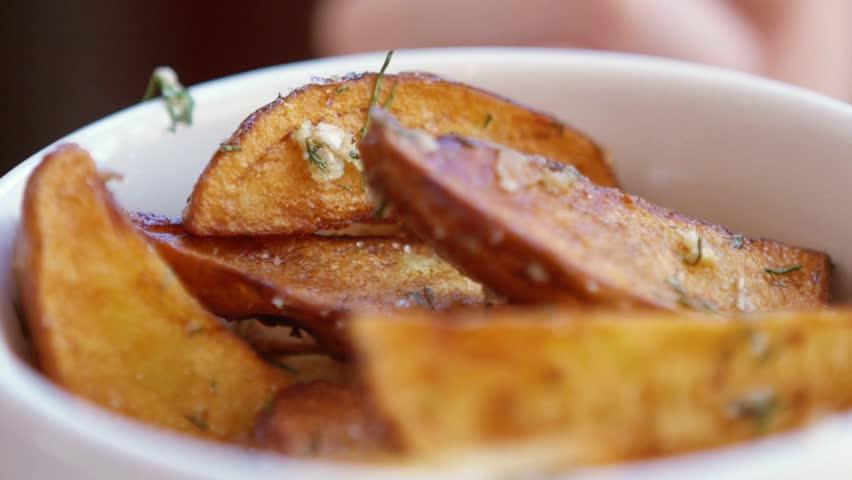 SLOW MOTION: young caucasian girl eats fresh fried potatoes - HD stock footage clip