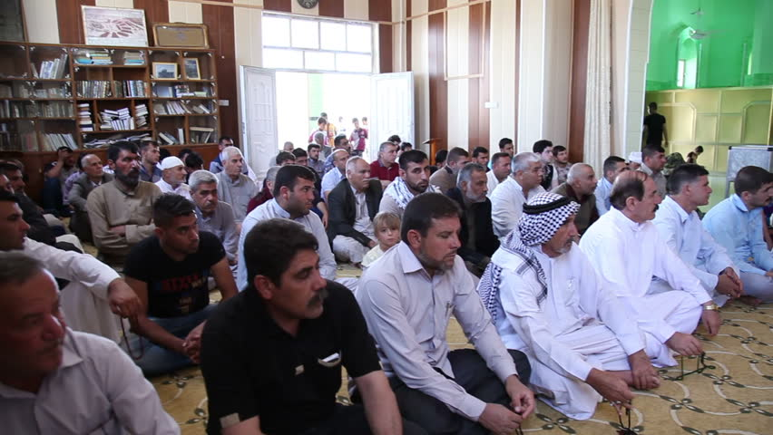 AMERLI, IRAQ - MAY 2015: Muslim men listen to Friday Sermon inside Imam Hasan Mosque. Amerli steadfastness to ISIS was a turning point in the war between Iraqi government and ISIS