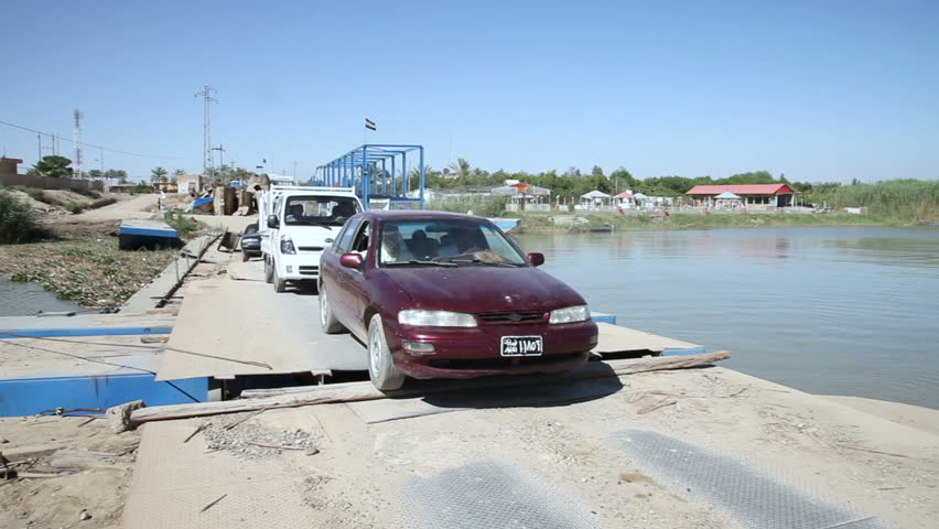 DHULUIYA BRIDGE, IRAQ - MAY 2015: Cars cross bridge. Dhuluiya Bridge is a vital bridge connecting Dhuluiya to Balad. On July 2014 ISIS exploded the Bridge to prevent the arrival of Iraqi forces