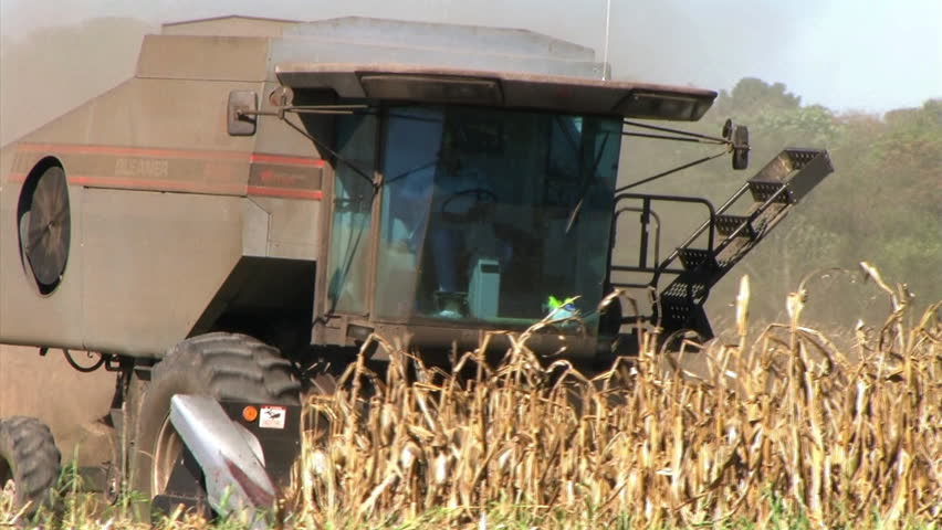 Combine Farming Corn 02 - audio from external microphone. - HD stock footage clip